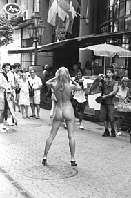 Naked woman on Budapest street (rear view).jpg