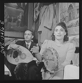 Turkish Americans - Orchestra in a Turkish nightclub on Allen Street. The girl plays a tambourine between dances (1942).