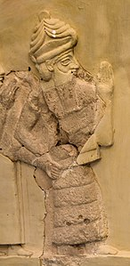 Ningishzida, with snakes emanating from his shoulders, on a relief of Gudea.jpg