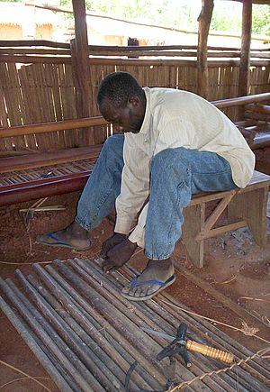Njem people - Njem man making shelf
