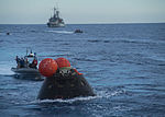 Orion capsule is towed to the well deck of the USS Anchorage (141206-N-FV739-227).jpg