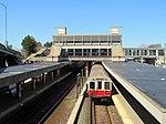 Outbound Braintree Branch train at JFK UMass station, April 2016.JPG