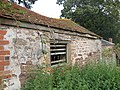 Outbuilding by a nettle-strewn footpath - geograph.org.uk - 1460837.jpg