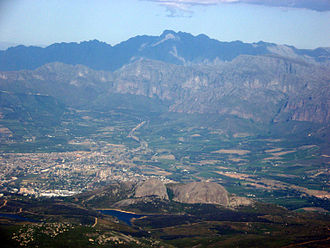 Paarl - Paarl Rock in foreground with the town behind it and Du Toit's Peak towering behind