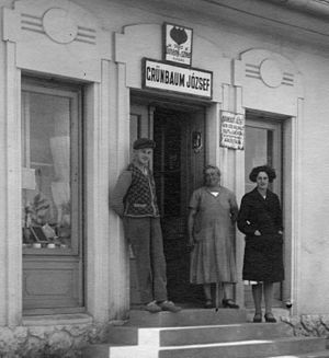 History of the Jews in Hungary - A Hungarian Jewish family standing in front of a country grocery shop, 1930s.