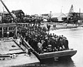 Passengers from the SS Ohio disembarking from a barge at a dock , Nome, Alaska, June 9, 1906 (AL+CA 2394).jpg