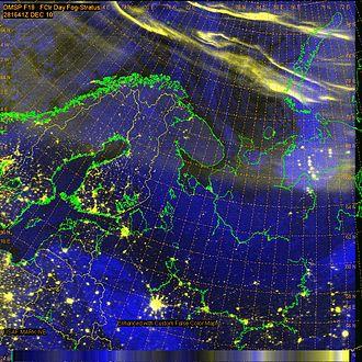Defense Meteorological Satellite Program - DMSP images of Auroral bands circling north of Scandinavia