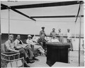 Photograph of President Truman and members of his party lounging in the sun on the after deck of his yacht, the... - NARA - 199033.tif