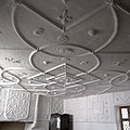 Plas Mawr - interior, view of plasterwork in chamber over brewhouse.jpg