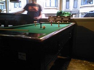 Bar billiards - Table with mushroom-style skittles