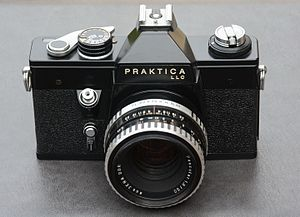 Praktica - Praktica LLC with Pancolar 1,8/50 lens, the first 35 mm single-lens reflex camera with electrical diaphragm simulation between interchangeable lenses and camera body (1969)