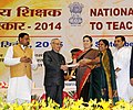 Pranab Mukherjee presenting the National Award for Teachers-2014 to Smt. S. Swarnabai, Tamil Nadu, on the occasion of the 'Teachers Day', in New Delhi. The Union Minister for Human Resource Development, Smt. Smriti Irani.jpg