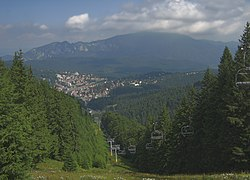 View of Predeal from Clăbucet-plecare Chalet (1445m);[1] behind is the Postăvarul massif