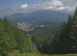 "View of Predeal from Clăbucet-plecare Chalet (1445m); behind is the <a href=""http://search.lycos.com/web/?_z=0&q=%22Post%C4%83varul%22"">Postăvarul</a> massif"
