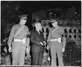 """President Harry S. Truman poses with two members of the military police who guard the """"Little White House,"""" the... - NARA - 198697.tif"""