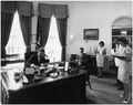 President addresses AMVETS Convention in New York City by telephone. President Kennedy, assistants. White House, Oval... - NARA - 194181.tif