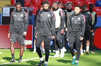 Jesse Lingard - Lingard (right) with teammates Rashford and Bailly before a Champions League match in 2017
