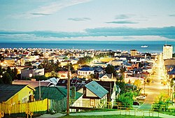 Nighttime summer view of Punta Arenas. In the background the Strait of Magellan and the north coast of Tierra del Fuego (Isla Grande de Tierra del Fuego)