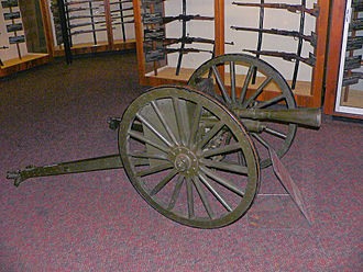 Canon d'Infanterie de 37 modèle 1916 TRP - A gun fitted with a gun shield, Flash suppressor and wheels, displayed at the United States Army Ordnance Museum, 2007