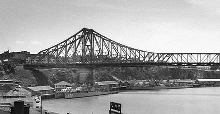 George K. MacKenzie, Leonard F. Mason, Henry W. Tucker and Rupertus under the Story Bridge, Brisbane, Australia in January 1958. QSA Item ID 436402 United States Navy ships under the Story Bridge, Brisbane, January 1958 cropped.jpg