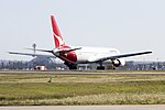Qantas (VH-OGL) Boeing 767-338ER taking off on runway 25 at Sydney Airport.jpg