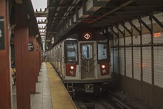 7 (New York City Subway service) - Queens-bound 7 express train of R188s leaving Fifth Avenue