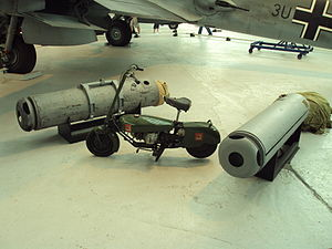 Central Landing Establishment - CLE Canisters displayed at the Royal Air Force Museum Cosford, along with a Corgi lightweight, folding motorcycle (2010)