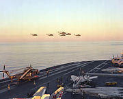 RH-53Ds fly over USS Nimitz April 1980