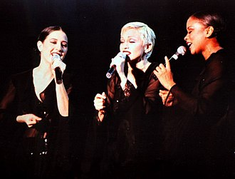 "Rain (Madonna song) - Madonna and her backup singers, Niki Haris (right) and Donna De Lory (left), performing ""Rain"" during The Girlie Show World Tour in 1993"