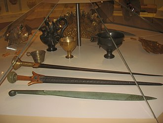 Mycenae - Museum replicas of Mycenaean swords and cups.