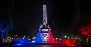 Reactions to the November 2015 Paris attacks - The Rizal Monument in Manila illuminated in the colors of the French flag after the attacks