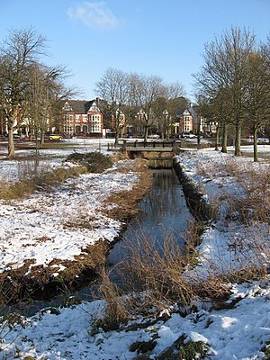 Roath - Roath Brook flowing through Roath Park in the snow