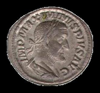 Numismatics - A Roman denarius, a standardized silver coin.