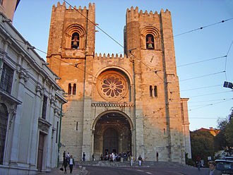 Portuguese Romanesque architecture - The facade of Lisbon Cathedral has two bell towers in the Norman manner and a wheel window.