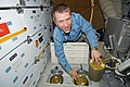 STS-125 Pilot Johnson Replaces LiOH Cannisters on the Shuttle Atlantis Middeck (28162760971).jpg