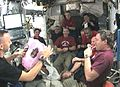 STS129 bresnik baby celebration.jpg