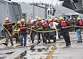 Sailors and Navy civilian employees dock USS John C. Stennis. (9183903387).jpg