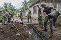 Sailors place concrete during the construction of the Health Clinic in Walung, Kosrae. (34805863756).jpg