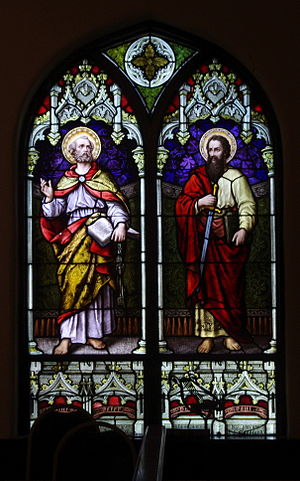 To rob Peter to pay Paul - A stained glass depiction of Saints Peter and Paul