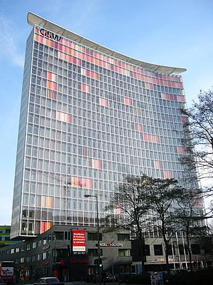 Sauerbruch Hutton - GSW Headquarters building in Berlin. The windows are polychromatic pastel hues of orange and rose when the window shades are closed.
