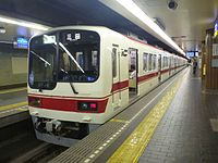 Shintetsu 2000 Kobe Rapid train at Shinkaichi Station 20130608 (9017815418).jpg