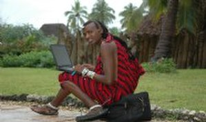Computer Aid International - Tanzanian Masai student, Simba using Computer Aid laptop