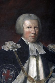 An rough oil painting portrait of an old white man with grey hair (or wig), robed as the Prelate of the Order of the Garter, with preaching bands and a blue outer cloak bearing the St George's Cross emblem of the Order.