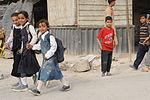 Soldiers, Iraqi national policemen distribute school supplies in Baghdad DVIDS157236.jpg