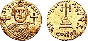 Cross - Early use of a globus cruciger on a solidus minted by Leontios (r. 695–698); on the obverse, a stepped cross in the shape of a Iota Eta monogram.