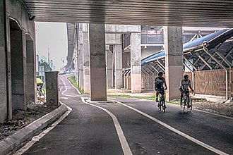 Cycling in Kuala Lumpur - Southwest Dedicated Bicycle Highway heading from Jalan Klang Lama. On the right side is the building of Mid Valley Komuter station.