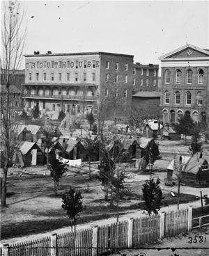 """Trout House - Trout House visible at back of this photo of State Square during Civil War, when the square was the site of a """"tent hospital"""""""