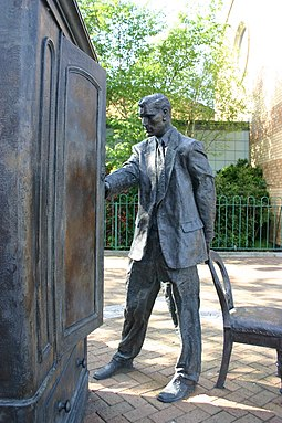 Statue of C. S. Lewis in front of the wardrobe from his Narnia book The Lion, the Witch and the Wardrobe Statue of C.S. Lewis, Belfast.jpg