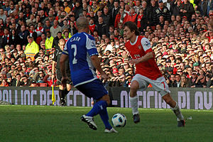 Tomáš Rosický - Rosický (right) playing in the Premier League against Birmingham City in October 2010