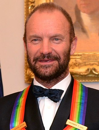 Sting with his 2014 Kennedy Center Honoree Medallion, on 6 December 2014 Sting 2014.jpg